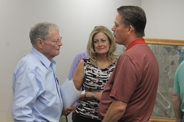 CHESLEY OXENDINE/Special to the Phoenix<br /> U.S. Senator Jim Inhofe, left, talks with State Senator Kim David and State Representative George Faught. Inhofe was in Muskogee Friday morning and said he is against the proposed U.S. 69 bypass.