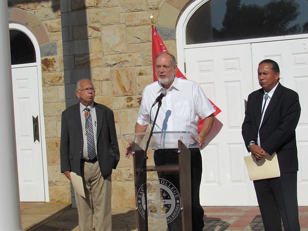 CATHY SPAULDING/Muskogee Phoenix<br /> Muskogee grocer Bill Johnson, center, flanked by Bacone<br /> College Board of Trustees Chairman Chief Ken Adams, left, and Bacone President Ferlin Clark, talks about his purchase of Bacone Commons properties in the former Northpointe Plaza shopping center.
