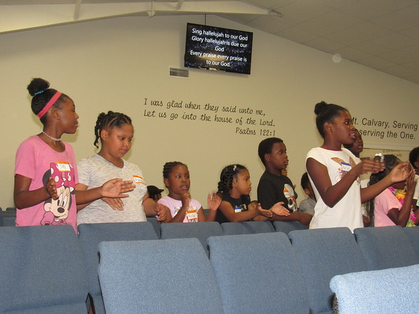 CATHY SPAULDING/Muskogee Phoenix Youngsters sing praises before Vacation Bible School at Mount Calvary Baptist Church. The church's new facility features video screens and Bible verses on the walls.