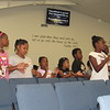 CATHY SPAULDING/Muskogee Phoenix<br /> Youngsters sing praises before Vacation Bible School at Mount Calvary Baptist Church. The church's new facility features video screens and Bible verses on the walls.