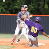 Phoenix special photo by Von Castor<br /> Three Rivers' Bailey Dorr turns a double play as Vian's Elijah Girty slides into second Friday evening at Connors State in Warner.