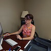 KENTON BROOKS/Muskogee Phoenix<br /> Lisa Snell, executive director of Fort Gibson Lake Association, works on the association's website at her desk. Snell wants to eventually print a magazine for the association.