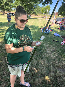 CHESLEY OXENDINE/Special to the Phoenix Blowdart competitor Geri Cruz inspects some prepared wooden darts before her participation in the 13th annual Traditional Native Games on Saturday.