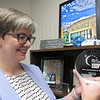 CATHY SPAULDING/Muskogee Phoenix<br /> Melissa McLain admires an award she received for her work with American Cancer Society. She said she devotes much of her spare time to her organization.