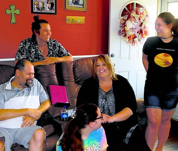 ABIGAIL HALL/Muskogee Phoenix Brian Davis, left, shares a moment with his wife, Nikki, seated to his right, and their children, Wyatt, Lexi and Alexandria. Brian is celebrating his first Father's Day following a kidney transplant.