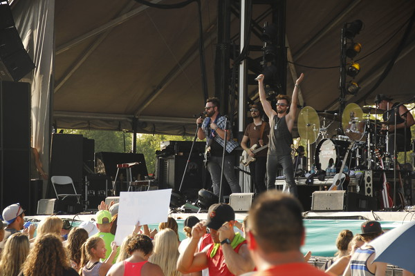 Staff photo by Harrison Grimwood<br /> The Swon Brothers perform for a hometown crowd Friday at the Love Bottling Stage at G Fest. The Muskogee duo tours nationally.