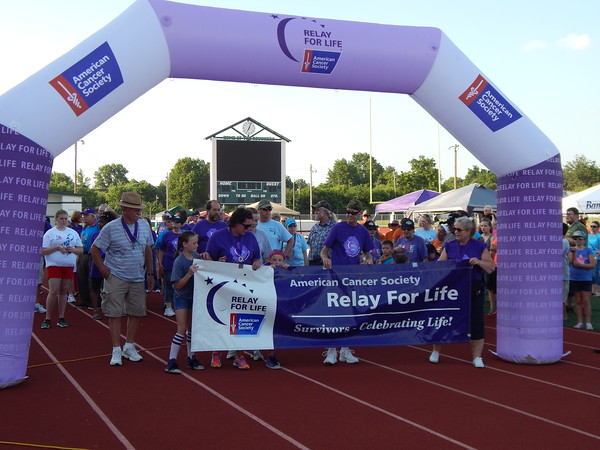Staff photo by Cathy Spaulding<br /> Cancer survivors prepare to walk the opening lap of the Relay for Life, a marathon held Friday at Indian Bowl Stadium. It raised money for the American Cancer Society.
