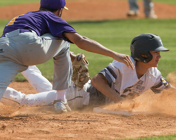 Phoenix special photo by Von Castor<br /> Three Rivers' Tyson Fourkiller slides into third base ahead of the tag of Vian's Kaleb Glass in Saturday's action at the Muskogee Nissan Classic in Warner.