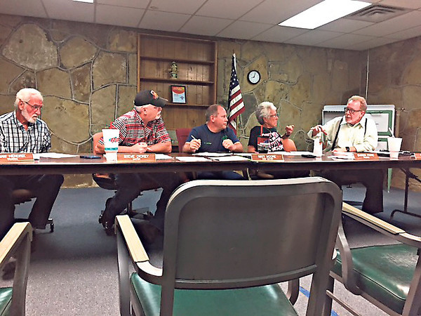 Staff photo by Mike Elswick<br /> Town of Porter Public Works Authority members, from left, Sam Hendrix, Mayor Steve Dickey, Matt Moore and Sharon Payne consult Thursday during a special meeting with Town Attorney Ronald Cates about pending litigation.