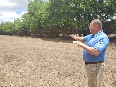 CHESLEY OXENDINE/Muskogee Phoenix Muskogee County District 1 Commissioner Ken Doke gives a tour of pastures drowned by the near-record flooding of the Arkansas River. Doke lost nearly 90 percent of his grazing pastures to the rising waters.