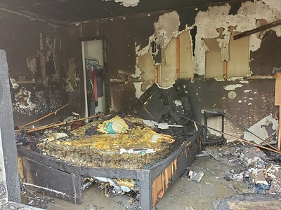 CHESLEY OXENDINE/Muskogee Phoenix A Monday morning fire ripped through the bedroom of Apartment 105 at the Village East Apartments off York Street.