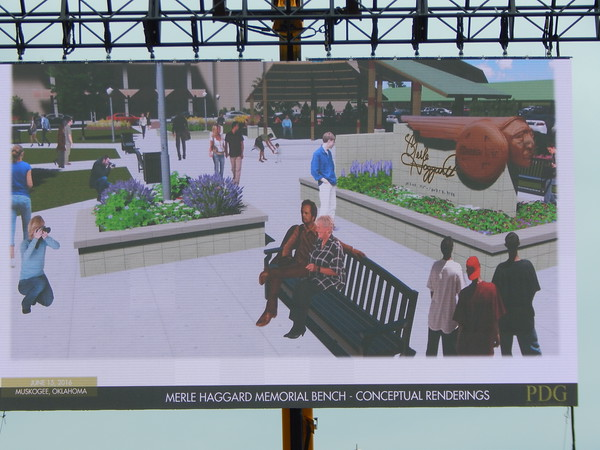 Staff photo by Mark Hughes<br /> An animated video displays the planned Merle Haggard Plaza, including the Santa Fe Monument designed and commissioned by Haggard. The plaza will also have a bench with a life-size bronze statue of Haggard. It will be in front of the Muskogee Civic Center.