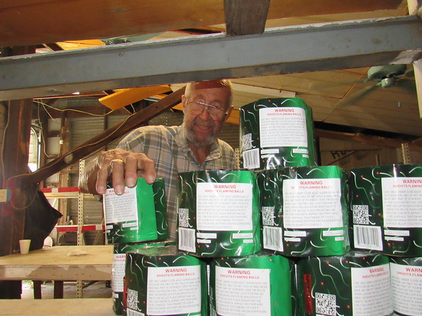 CATHY SPAULDING/Muskogee Phoenix<br /> Bill Rector of Rector Fireworks stacks fireworks on his warehouse shelves. He said fireworks stands usually get extra busy on the eve of Independence Day.