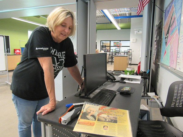 Marybeth Flusche keeps a newspaper article about pioneer educator Alice Robertson as a memento of her 22 years of teaching at the New Tech at Alice Robertson Junior High. She retired at the end of the school year.