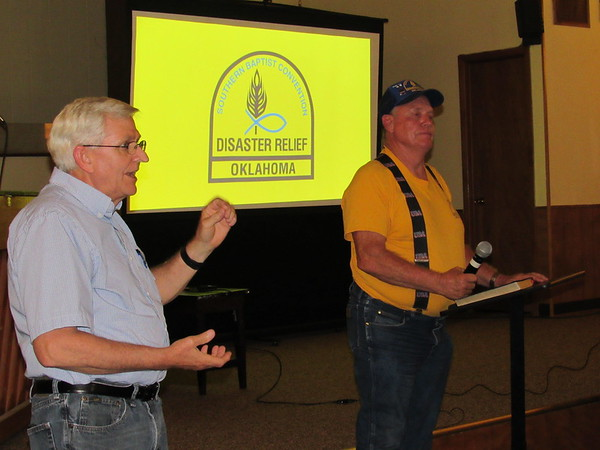 CATHY SPAULDING/Muskogee Phoenix<br /> Muskogee Baptist Association Missions Director Norm Howell, left, and Lonnie Rowan of Southern Baptist Convention Disaster Relief discuss the need to help residents affected by recent floods. Dozens attended a workshop conducted by Disaster Relief.