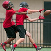 Phoenix special photo by Von Castor<br /> Hilldale's Grant Sikes, right, catches a pass in front of Wagoner's Eric Farbes during the teams 7-on-7 drill on Thursday in Wagoner.