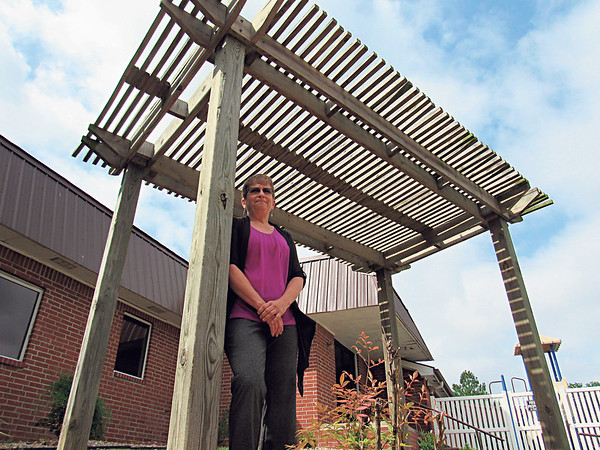Staff photo by Cathy Spaulding<br /> The Rev. Dawn Richards, new pastor at First United Methodist Church, Fort Gibson, said she wants to bring ministry outside church walls. She said she wants to place a prayer bench at this arbor.