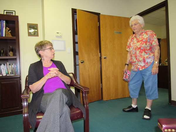 Staff photo by Cathy Spaulding<br /> The Rev. Dawn Richards, left, visits with Kathryn Hendrix, a longtime member of First United Methodist Church Fort Gibson. Richards became church pastor earlier this month.