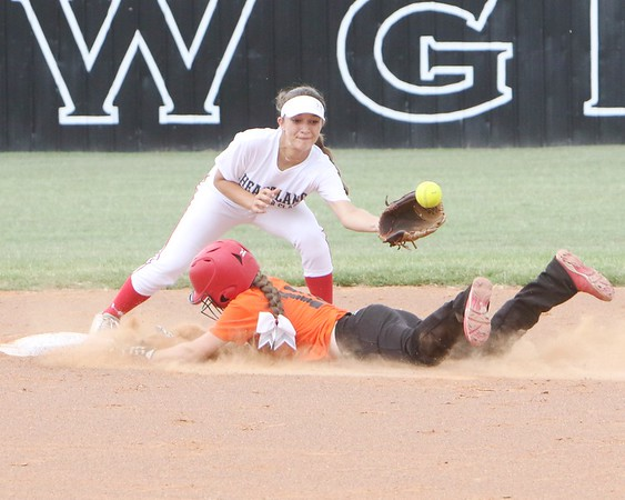 JOHN HASLER/Phoenix special photo Orange's Judy Dean of Shidler, Oklahoma, beats a late throw to White's Kirstyn Rech at second base.