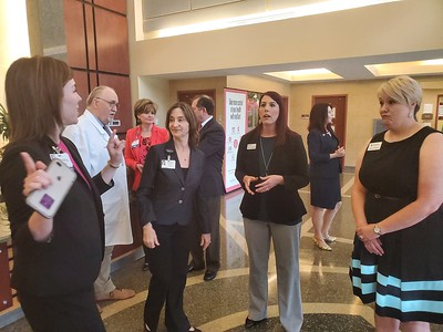 CHESLEY OXENDINE/Muskogee Phoenix (from left to right) Executive Director of Corporate Communications at Saint Francis Hospital, Lauren Landwerlin, and Saint Francis Health System Vice President Michele Keeling have a chat with Red Cross Oklahoma Regional Philanthropy Officer Sara Flowers and Central and South Texas Regional Chief Development Officer Sunny Howard after the hospital donated $100,000 to the organization's disaster relief effort.