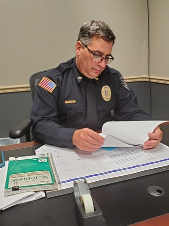 CHESLEY OXENDINE/Muskogee Phoenix<br /> Haskell Police Chief Michael Keene spends a few moments behind his desk on his first day on the job.