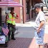 """Staff photo by Harrison Grimwood<br /> """"The Walking Veteran,"""" Thomas Wayne Hudson, left, chats with Glenn Stewart of Owasso as he passes through Muskogee. Hudson is walking from Las Vegas to Washington to bring attention to """"the abuses that veterans endure,"""" according to his website,  <a href=""""http://www.walkingveteran.com"""">http://www.walkingveteran.com</a>. While in Muskogee, he visited the regional office of the Department of Veterans Affairs on behalf of a disabled veteran, hoping to help her get benefits for service-related injuries. Hudson's website says his journey will conclude with a rally in Washington on Veterans Day."""