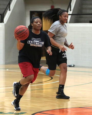 JOHN HASLER/Phoenix Special Photo<br /> Oklahoma Warriors Bethany Hall and Tonisha Dean work out in a practice this week at the Civic Center. The Warriors begin their inaugural season in the Women's Minor League Basketball Association this weekend in Topeka, Kan.