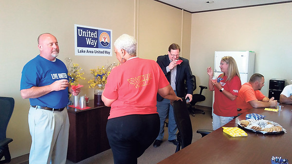 Staff photo by Wendy Burton<br /> Visitors and Lake Area United Way board members chat in the large meeting room at LAUW's new offices during an open house on Wednesday. The new offices are located on the second floor of the Arvest Bank building at 230 W. Broadway.