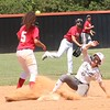 Phoenix special photo by John Hasler<br /> Mairady Dempsey sneaks into second on a double in the first inning for White, which lost to Red 11-2 in the final.
