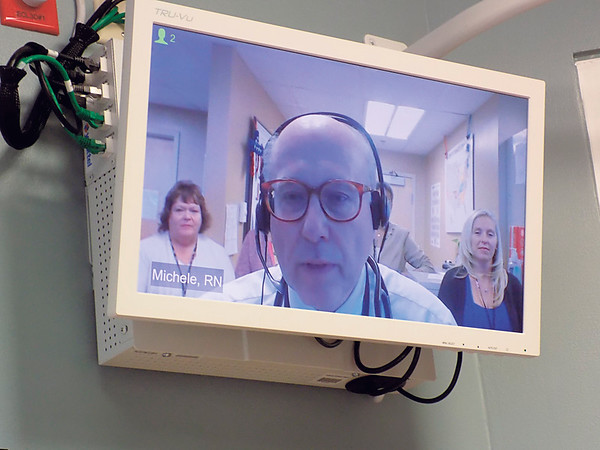 Staff photo by Mike Elswick<br /> Dr. Ralph Panos, medical director of the VA's ICU program in Cincinnati, visits with Muskogee VA medical officials Wednesday via new teleconferencing equipment installed in the 11 Intensive Care Unit rooms as well as three emergency rooms. The capability will allow Jack C. Montgomery medical staff to get real-time medical advice around the clock through the VA ICU staff in Cincinnati.