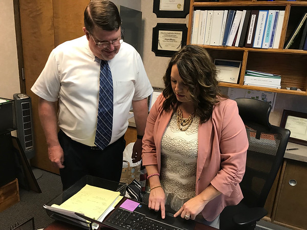 CATHY SPAULDING/Muskogee Phoenix<br /> New Indian Capital Technology Center Muskogee Campus Director Greg Phares goes over a computer program with Assistant Director Angela Kohl. Phares spent the past 22 years as Fort Gibson Middle School principal.