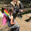 CHESLEY OXENDINE/Muskogee Phoenix<br /> Performer Bob Hollister entertains some kids after a May 12 show during the Muskogee Renaissance Festival.