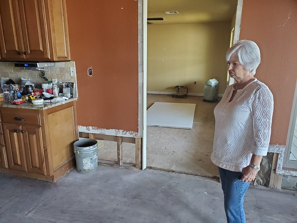 CHESLEY OXENDINE/Muskogee Phoenix Webbers Fall Mayor Sandy Wright surveys her home after cleanup from flooding has begun.