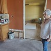 CHESLEY OXENDINE/Muskogee Phoenix<br /> Webbers Fall Mayor Sandy Wright surveys her home after cleanup from flooding has begun.
