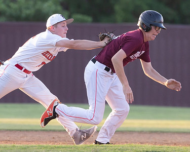 VON CASTOR/Phoenix Special Photo Hilldale's Evan Smith tags Maroon's Joey Thornton in a run-down Friday evening in the first round of the Heartland Baseball All-Star Classic at Warner High School.