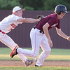 VON CASTOR/Phoenix Special Photo<br /> Hilldale's Evan Smith tags Maroon's Joey Thornton in a run-down Friday evening in the first round of the Heartland Baseball All-Star Classic at Warner High School.