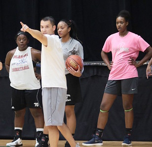 Oklahoma Warriors assistant coach Jon Minor directs practice as players Jordan Evans, Tonisha Dean and Shaunda Hagler look on during a practice this week at Muskogee Civic Center.