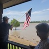 Webbers Fall Mayor Sandy Wright (right) watches as her husband<br /> James Wright fixes a flagpole on their back porch overlooking a swollen Arkansas River.