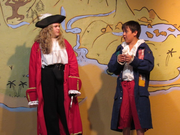 """Staff photo by Cathy Spaulding<br /> Above, Captain Hook (Riley Raasch, left) gets a less than flattering report from Smee (Shiloh Moore) in the Summer Youth Theatre production of """"Disney's Peter Pan Jr."""""""