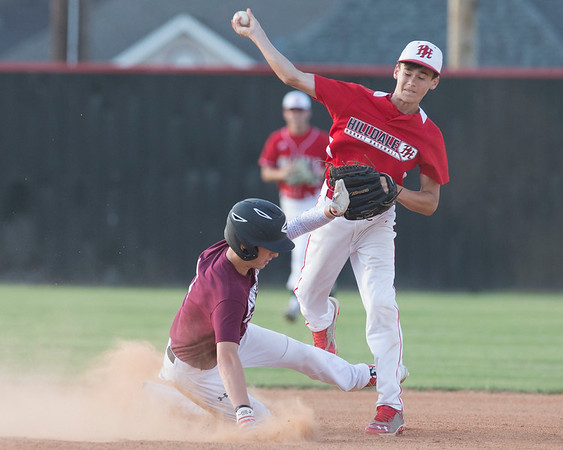 Phoenix special photo by Von Castor<br /> Hilldale's Colby Thompson tries to turn a double play as Maroon's Dally Ellis slides into second base Friday evening in the nightcap game of the Heartland Classic at Hornet Field.
