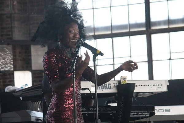 CHESLEY OXENDINE/Muskogee Phoenix<br /> Singer Branjae dons a wig during one of her songs at Soul Fest on Saturday evening.