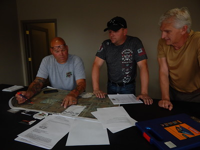 KENTON BROOKS/Muskogee Phoenix Wagoner Mayor Albert Jones, right, talks with promoters John Woolley, left, and J.W. Barry over the map for the Bulldog Bite Street Race scheduled for June 30 on 15th Street.