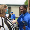 CATHY SPAULDING/Muskogee Phoenix<br /> Oklahoma School for the Blind Night Supervisor Jennifer Ogle visits with OSB graduate Kentrell Wallace after the school's commencement ceremony Tuesday. Wallace had attended OSB since fifth grade.