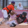 Phoenix special photo by VonCastor<br /> Hilldale's Kobe Kuykendall slides under Oklahoma Orange catcher Graylen Fletcher for the Hornets' sec- ond run Friday evening in the opening round of the Heartland All-Star Classic at Hilldale.