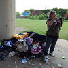 Staff photo by Wendy Burton<br /> Jana Younker, a homeless woman living under the Columbus Street overpass near the Gospel Rescue Mission, talks about her reason for living there, her plans to clean the area up, and the possibility of going to jail for failure to pay littering and trespassing fines.