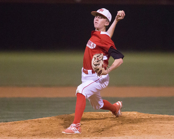Phoenix special photo by Von Castor<br /> Hilldale's Kaden Bass throws a pitch against Gold Saturday in the Heartland Classic at Hilldale.