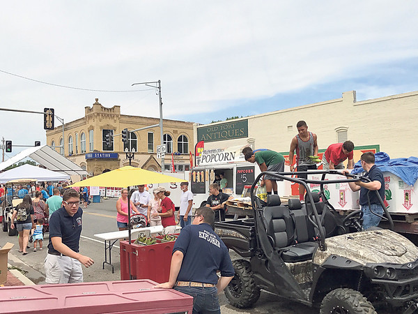 Special photo by Travis Sloat<br /> The Fort Gibson High School football team tossed bushels of corn instead of pigskins Saturday, as customers lined up to buy bags of the seasonal corn. All of the proceeds from the festival go into Fort Gibson's Parks and Recreation fund, Mayor Myra Cookson said.
