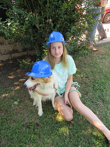 CATHY SPAULDING/Muskogee Phoenix Emily Miller, 14, sits with a collie mix named Warren before the ground-breaking for Muskogee Animal Shelter expansion on Monday.