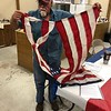 CHESLEY OXENDINE/Muskogee Phoenix<br /> Lanny Cartwright displays the remnants of a tattered American flag. Such flags will be disposed of honorably in a ceremony Saturday.