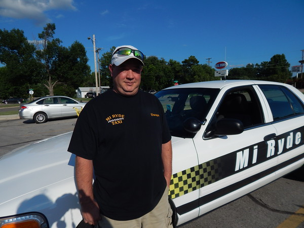 KENTON BROOKS/Muskogee Phoenix<br /> Dwayne Parent stands by his Mi Ryde taxi cab as he has begun the company for the third time since 2003. Parent said Muskogee city officials asked him to open again because of the demand for taxi service in Muskogee.
